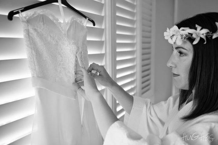 Bridal Prepares to Slip Into Her Dress